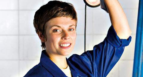 Female mechanic, smiling, portrait